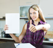 Smiling woman with documents Royalty Free Stock Image