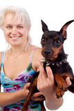 Smiling woman and dog. Cute happy woman holding her small dog Royalty Free Stock Images