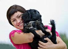 Smiling woman with dog Stock Photo