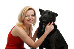Smiling woman with a dog Royalty Free Stock Photo