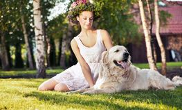 Smiling woman with dog Stock Photography