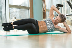 Smiling Woman Doing Abdominal Excerise Stock Photo