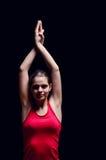 Woman smiling and doing yoga Stock Photos