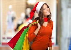 Smiling woman doing Christmas shopping Stock Photo
