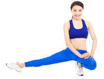 Smiling  woman doing core workout, warm up body Royalty Free Stock Images
