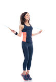 Smiling woman doing exercises with jumping rope Royalty Free Stock Image