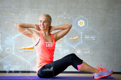 Smiling woman doing exercises on mat in gym Royalty Free Stock Photo