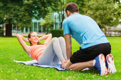 Smiling woman doing exercises on mat outdoors Royalty Free Stock Photo