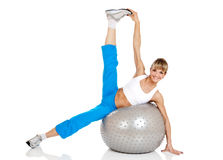Smiling woman doing fitness exercise with fit ball Royalty Free Stock Images