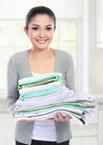 Smiling woman with laundry Stock Image