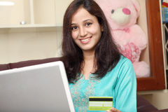 Smiling woman doing online shopping Royalty Free Stock Photo