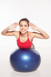 Smiling woman doing pilates Stock Images