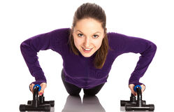 Smiling woman doing push-ups Royalty Free Stock Photos