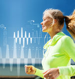 Smiling woman doing running outdoors Stock Photo
