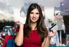 Smiling woman doing shopping Royalty Free Stock Photos