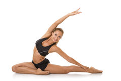 Smiling woman doing stretching exercise Royalty Free Stock Photography
