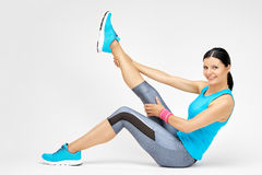 Smiling woman doing stretching pilates exercises at the gym Royalty Free Stock Photography