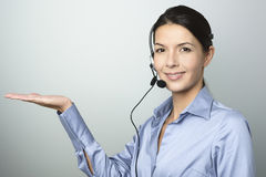 Smiling woman doing telemarketing Royalty Free Stock Photos