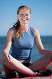 Smiling woman doing Yoga Stock Image