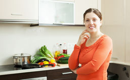 Smiling woman   in domestic kitchen Stock Photos