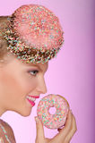 Smiling woman with donut on head and in hand Royalty Free Stock Photos