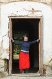 Smiling Woman in Doorway Royalty Free Stock Image