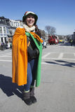 Smiling woman draped with Irish flag, St. Patrick's Day Parade, 2014, South Boston, Massachusetts, USA Royalty Free Stock Photography