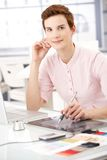 Smiling woman with drawing pad Royalty Free Stock Photos