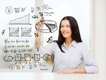 Smiling woman drawing plan on virtual screen Stock Photos