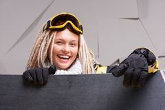 Smiling woman with dreadlocks looking out the Royalty Free Stock Photography