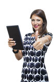 Smiling Woman in a Dress Holding a Tablet Computer Stock Photography