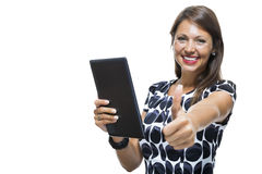 Smiling Woman in a Dress Holding a Tablet Computer Royalty Free Stock Photography