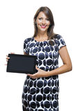 Smiling Woman in a Dress Holding a Tablet Computer Stock Photo