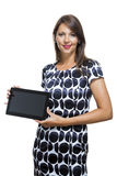 Smiling Woman in a Dress Holding a Tablet Computer Royalty Free Stock Photos