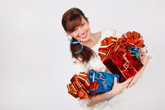 Smiling woman in dress holds three boxes with gifts Royalty Free Stock Images