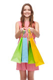 Smiling woman in dress with many shopping bags Royalty Free Stock Photo