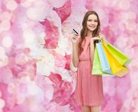 Smiling woman in dress with many shopping bags Stock Photo