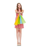 Smiling woman in dress with many shopping bags Stock Image