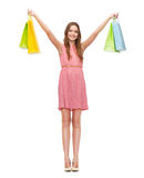 Smiling woman in dress with many shopping bags Royalty Free Stock Photography