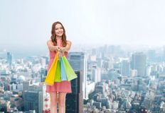 Smiling woman in dress with many shopping bags Stock Photos