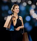 Smiling woman in dress with shopping bags Royalty Free Stock Photos