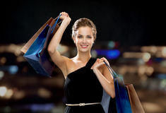 Smiling woman in dress with shopping bags Royalty Free Stock Photo