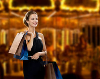 Smiling woman in dress with shopping bags Royalty Free Stock Images