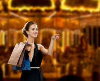 Smiling woman in dress with shopping bags Stock Images
