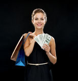 Smiling woman in dress with shopping bags Royalty Free Stock Photography