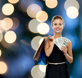 Smiling woman in dress with shopping bags Stock Photography