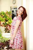 Smiling woman in dress standing Stock Photo