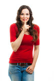 Smiling woman dressed in red doing a silence sign Royalty Free Stock Images