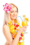 Smiling woman dressed in a traditional costume drinking cocktail Stock Photos