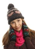 Smiling woman dressed in winter clothes stock photo